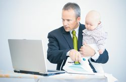 Dad-Holding-Baby-at-Computer