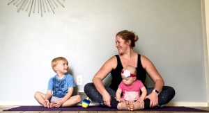 Erin Marsh shares a smile with son Dexter and daughter Camille during family yoga time.