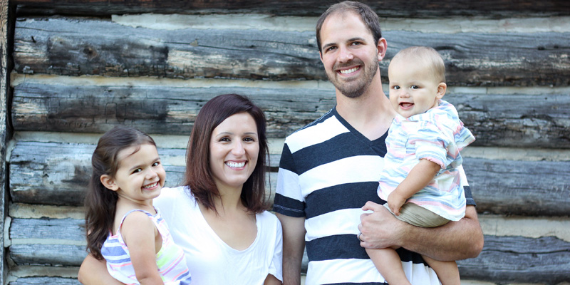 Eric Swindel, preschool intervention specialist, with his wife Andrea and their children, Elise and Elijah.