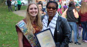 Ellie Leonard receives a proclamation from Toledo Mayor Paula Hicks-Hudson for her work on the trail.