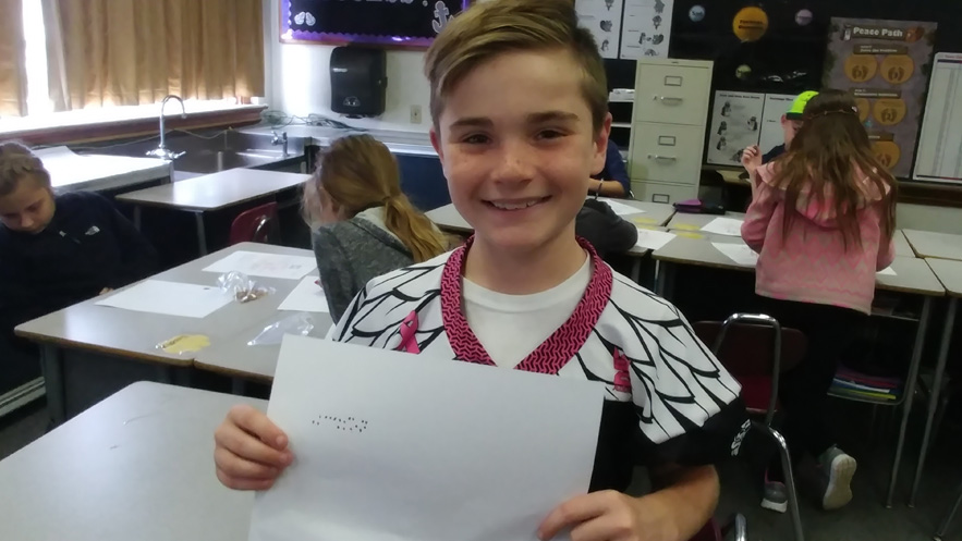 Jackson shares his name in braille.