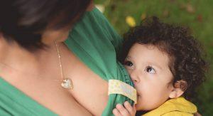 Michelle Bucur nursing her youngest child Shoshana Elisateta