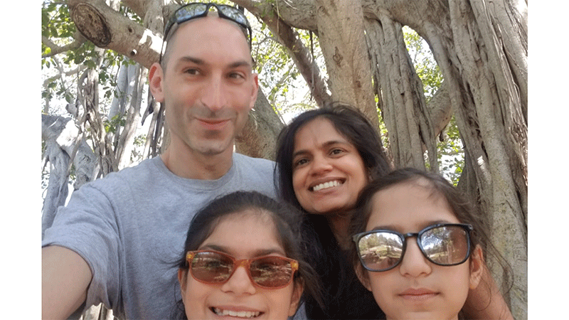 Dr. Aparna and Chris Brown with daughters Tara and Nora.