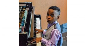 Gregory Jr. playing piano by J. Pickering Photography