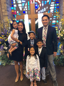 Delos Reyes family celebrating together at church