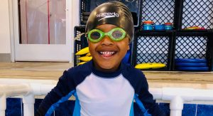 Four-year-old Braxton having fun in the pool during his swim lesson.