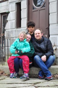 """Emily Bedwell and Mike Deetsch with their children, Ethan and Cassady. Photo taken by Heather Meyer as part of the """"Porch Project."""""""