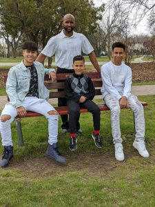 Phil and his sons, Jayden, Elijah and Kingston.